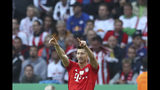 Bayern's Robert Lewandowski celebrates his goal against RB Leipzig during the German soccer cup, DFB Pokal, final match between RB Leipzig and Bayern Munich at the Olympic stadium in Berlin, Germany, Saturday, May 25, 2019. (AP Photo/Matthias Schrader)