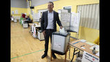 Taoiseach Leo Varadkar casts his vote at Scoil Thomais, Castleknock as people across the Republic of Ireland go to the polls to vote in the European and local elections along with the referendum on Ireland's divorce laws, in Dublin, Friday May 24, 2019. (Brian Lawless/PA via AP)