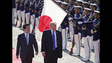 FILE - In this Nov. 6, 2017, file photo, U.S. President Donald Trump, second from left, reviews an honor guard during a welcome ceremony, escorted by Japanese Prime Minister Shinzo Abe at Akasaka Palace in Tokyo. Trump's Japan visit starting on Saturday, May 25, 2019, is to focus on personal ties with Abe rather than substantive results on trade, security or North Korea.(AP Photo/Koji Sasahara, Pool, File)