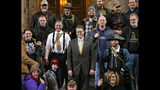 """FILE - In this Jan. 15, 2015, file photo, Washington Rep. Matt Shea, R-Spokane Valley, center, poses for a group photo with gun owners inside the Capitol in Olympia, Wash., following a gun-rights rally. Recently published internet chats from 2017 show Shea and three other men discussing confronting """"leftists"""" with a variety of tactics, including violence, surveillance and intimidation. The messages prompted Washington House Democrats to demand that Shea be reprimanded for a history of far-right speech and activities. (AP Photo/Ted S. Warren, File)"""