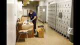 In this Thursday, May 9, 2019 photo, St. Petersburg Police Detective Wally Pavelski works on evidence for major crimes cold cases at the old St. Petersburg Police Department building in St. Petersburg, Fla. The old St. Petersburg Police Department building is full of horror stories. Labyrinths of desks. Haunted evidence lockers. Archaic plumbing. Dungeon-like, windowless buildings. So the detectives and civilians who make up the 800-member force are thrilled to be moving to the shiny new state-of-the-art building across the street. (Dirk Shadd/Tampa Bay Times via AP)