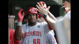 Cincinnati Reds' Yasiel Puig celebrates with teammates after hitting a solo home run against the Chicago Cubs during the fifth inning of a baseball game Saturday, May 25, 2019, in Chicago. (AP Photo/Nam Y. Huh)
