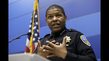 """FILE - In this May 21, 2019, file photo, San Francisco Police Chief William Scott answers questions during a news conference in San Francisco. Scott is apologizing for raiding a freelance journalist's home and office to find out who leaked a police report into the unexpected death of the city's former public defender. Scott told the San Francisco Chronicle on Friday, May 24, 2019, the searches were probably illegal and said, """"I'm sorry that this happened."""" (AP Photo/Eric Risberg, File)"""