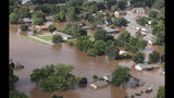 Homes are flooded near the Arkansas River in Tulsa, Okla., on Friday, May 24, 2019. The threat of potentially devastating flooding continued Friday along the Arkansas River from Tulsa into western Arkansas. (Tom Gilbert/Tulsa World via AP)
