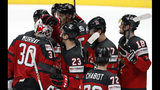 Canada players celebrate with their goaltender Matt Murray, left, at the end of the Ice Hockey World Championships semifinal match between Canada and Czech Republic at the Ondrej Nepela Arena in Bratislava, Slovakia, Saturday, May 25, 2019. Canada won 5-1. (AP Photo/Petr David Josek)