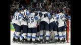 Finland's players celebrate after winning the Ice Hockey World Championships semifinal match between Russia and Finland at the Ondrej Nepela Arena in Bratislava, Slovakia, Saturday, May 25, 2019. (AP Photo/Ronald Zak)