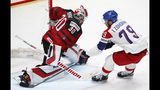 Canada's goaltender Matt Murray makes a save against Czech Republic's Tomas Zohorna, right, during the Ice Hockey World Championships semifinal match between Canada and Czech Republic at the Ondrej Nepela Arena in Bratislava, Slovakia, Saturday, May 25, 2019. (AP Photo/Petr David Josek)