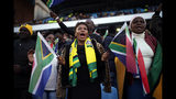 African National Congress party (ANC) supporters gather for the swearing-in ceremony for South African President Cyril Ramaphosa at Loftus Versfeld stadium in Pretoria, South Africa, Saturday May 25, 2019. Ramaphosa has vowed to crack down on the corruption that contributed to the ruling ANC' s weakest election showing in a quarter-century. (AP Photo/Jerome Delay)