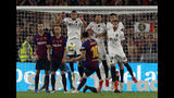 Barcelona forward Lionel Messi takes a free kick during the Copa del Rey soccer match final between Valencia CF and FC Barcelona at the Benito Villamarin stadium in Seville, Spain, Saturday. 25, 2019. (AP Photo/Miguel Morenatti)