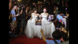 Taiwanese same-sex couples walk the red carpet at their wedding party in Taipei, Taiwan, Saturday, May 25, 2019. Taiwan became the first place in Asia to allow same-sex marriage last week. Hundreds of same-sex couples in Taiwan rushed to get married Friday, the first day a landmark decision that legalized same-sex marriage took effect. (AP Photo/Chiang Ying-ying)