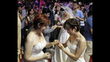Taiwanese same-sex couples exchange rings at their wedding party in Taipei, Taiwan, Saturday, May 25, 2019. Taiwan became the first place in Asia to allow same-sex marriage last week. Hundreds of same-sex couples in Taiwan rushed to get married Friday, the first day a landmark decision that legalized same-sex marriage took effect. (AP Photo/Chiang Ying-ying)