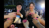Taiwanese same-sex couples cheer with supporters at their wedding party in Taipei, Taiwan, Saturday, May 25, 2019. Taiwan became the first place in Asia to allow same-sex marriage last week. Hundreds of same-sex couples in Taiwan rushed to get married Friday, the first day a landmark decision that legalized same-sex marriage took effect. (AP Photo/Chiang Ying-ying)