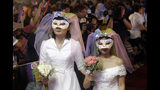 Taiwanese same-sex couples go red carpet at their wedding party in Taipei, Taiwan, Saturday, May 25, 2019. Taiwan became the first place in Asia to allow same-sex marriage last week. Hundreds of same-sex couples in Taiwan rushed to get married Friday, the first day a landmark decision that legalized same-sex marriage took effect. (AP Photo/Chiang Ying-ying)