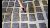 Ballots are being prepared ahead of Sunday's European Elections, in Rozzano, near Milan, Italy, Saturday, May 25, 2019. Some 400 million Europeans from 28 countries head to the polls from Thursday to Sunday to choose their representatives at the European Parliament for the next five years. (AP Photo/Antonio Calanni)