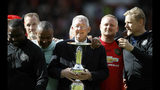 Manchester United Legends manager Sir Alex Ferguson with the trophy after the legends match between Manchester United Legends and Bayern Munich Legens at Old Trafford, Manchester, England, Sunday, May 26, 2019. (Martin Rickett/PA via AP)