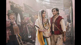 """This image released by Disney shows Naomi Scott as Jasmine and Mena Massoud as Aladdin, right, in Disney's live-action adaptation of the 1992 animated classic """"Aladdin."""" (Daniel Smith/Disney via AP)"""
