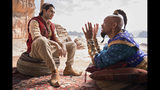 "This image released by Disney shows Mena Massoud as Aladdin, left, and Will Smith as Genie in Disney's live-action adaptation of the 1992 animated classic ""Aladdin."" (Daniel Smith/Disney via AP)"