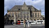 In this Tuesday, May 14, 2019 photo, the historic town hall shines in the evening sun in Bremen, Germany. The city became a battleground for EU's fragile political center, support for Germany's Social Democrats has ebbed dramatically in recent years, but nowhere is their fate more closely watched than in the tiny city-state of Bremen. (AP Photo/Martin Meissner)