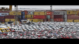Thursday, May 16, 2019 photo, cars for import and export park in the free harbour in Bremerhaven, Germany. The city became a battleground for EU's fragile political center, support for Germany's Social Democrats has ebbed dramatically in recent years, but nowhere is their fate more closely watched than in the tiny city-state of Bremen. (AP Photo/Martin Meissner)