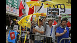 Pro-Beijing supporters destroy yellow umbrellas, used to mark protesting denouncing far-reaching Beijing control, during a demonstration in Hong Kong, Sunday, May 26, 2019. A vigil will be held on June 4 at the Victoria Park to mark the 30th anniversary of the military crackdown on the pro-democracy movement at Beijing's Tiananmen Square on June 4, 1989. (AP Photo/Kin Cheung)
