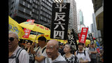 """Pro-democracy protesters carry placards with Chinese reads """"Vindicate June 4th"""" and """"Put an end to one-party Dictatorship"""" during a demonstration in Hong Kong, Sunday, May 26, 2019. A vigil will be held on June 4 at the Victoria Park to mark the 30th anniversary of the military crackdown on the pro-democracy movement at Beijing's Tiananmen Square on June 4, 1989. (AP Photo/Kin Cheung)"""