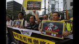 """Pro-democracy demonstrators carry placards with Chinese reads """"Withdraw extradition law, Vindicate June 4th"""" during a demonstration in Hong Kong, Sunday, May 26, 2019. A vigil will be held on June 4 at the Victoria Park to mark the 30th anniversary of the military crackdown on the pro-democracy movement at Beijing's Tiananmen Square on June 4, 1989. (AP Photo/Kin Cheung)"""