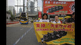 Pro-democracy protesters carry banners during a demonstration in Hong Kong, Sunday, May 26, 2019. A vigil will be held on June 4 at the Victoria Park to mark the 30th anniversary of the military crackdown on the pro-democracy movement at Beijing's Tiananmen Square on June 4, 1989. (AP Photo/Kin Cheung)