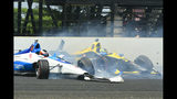 Felix Rosenqvist, of Sweden, left, and Zach Veach collide in the third turn during the Indianapolis 500 IndyCar auto race at Indianapolis Motor Speedway, Sunday, May 26, 2019, in Indianapolis. (AP Photo/Tom Pyle)