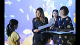 U.S. first lady Melania Trump, center, and Japanese Prime Minister Shinzo Abe's wife Akie Abe, right, talk with a girl as they visit a digital art museum Sunday, May 26, 2019, in Tokyo. (AP Photo/Koji Sasahara)