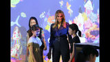 U.S. first lady Melania Trump talks with children during her visit to a digital art museum in Tokyo Sunday, May 26, 2019. (AP Photo/Koji Sasahara)