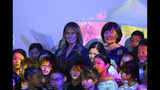 U.S. first lady Melania Trump, center, poses with Japanese Prime Minister Shinzo Abe's wife Akie Abe, right, and children for a photo during a visit to a digital art museum in Tokyo Sunday, May 26, 2019. (AP Photo/Koji Sasahara)