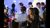 U.S. first lady Melania Trump talks with children as she visits a digital art museum Sunday, May 26, 2019, in Tokyo. (AP Photo/Koji Sasahara)