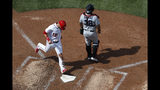 Washington Nationals catcher Yan Gomes (10) crosses home base to score past Miami Marlins catcher Jorge Alfaro (38) in the sixth inning of a baseball game Sunday, May 26, 2019, in Washington. (AP Photo/Jacquelyn Martin)