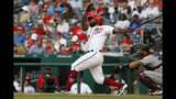 Washington Nationals' Howie Kendrick, left, follows through as he hits a home run against the Miami Marlins in the second inning of a baseball game, Sunday, May 26, 2019, in Washington. (AP Photo/Jacquelyn Martin)