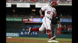 Washington Nationals' Howie Kendrick (47) rounds third as he heads home to score after hitting a homer against the Miami Marlins in the second inning of a baseball game, Sunday, May 26, 2019, in Washington. (AP Photo/Jacquelyn Martin)