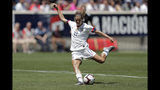 Unites States forward Tobin Heath shoots a scoring shot against Mexico during the first half of an international friendly soccer match, Sunday, May 26, 2019, in Harrison, N.J. (AP Photo/Julio Cortez)