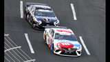 Kyle Busch (18) leads Kevin Harvick (4) during a NASCAR Cup Series auto race at Charlotte Motor Speedway in Concord, N.C., Sunday, May 26, 2019. (AP Photo/Mike McCarn)