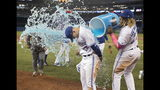 Toronto Blue Jays' Cavan Biggio gets a bucket shower from teammate Vladimir Guerrero Jr. during a post-game interview after the Jays defeated the San Diego Padres 10-1 in a baseball game in Toronto, Sunday, May 26, 2019. (Fred Thornhill/The Canadian Press via AP)
