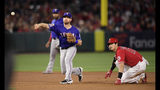 Los Angeles Angels' Shohei Ohtani, of Japan, looks back after being forced out at second as Texas Rangers second baseman Logan Forsythe throws out Albert Pujols at first during the fourth inning of a baseball game Saturday, May 25, 2019, in Anaheim, Calif. (AP Photo/Mark J. Terrill)