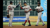 Boston Red Sox's Eduardo Nunez (36), Mookie Betts, center, and Jackie Bradley Jr. celebrate after a baseball game against the Houston Astros Sunday, May 26, 2019, in Houston. The Red Sox won 4-1. (AP Photo/David J. Phillip)