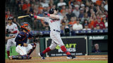 Boston Red Sox's Andrew Benintendi, right, hits a sacrifice fly to score Steve Pearce as Houston Astros catcher Robinson Chirinos watches during the third inning of a baseball game Sunday, May 26, 2019, in Houston. (AP Photo/David J. Phillip)