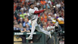 Boston Red Sox third baseman Rafael Devers throws to first for the out after fielding a ground ball off the bat of Houston Astros' Carlos Correa during the third inning of a baseball game Sunday, May 26, 2019, in Houston. (AP Photo/David J. Phillip)