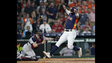Houston Astros' Aledmys Diaz, right scores as Boston Red Sox catcher Christian Vazquez covers home plate during the first inning of a baseball game Sunday, May 26, 2019, in Houston. (AP Photo/David J. Phillip)