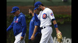 Chicago Cubs right fielder Kris Bryant, right, walks off the field with Chicago Cubs manager Joe Maddon, left, after he was injured during the sixth inning of a baseball game against the Cincinnati Reds Sunday, May 26, 2019, in Chicago. (AP Photo/Matt Marton)