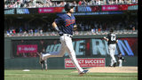 Minnesota Twins' Max Kepler, left, jogs home on his three-run home run off Chicago White Sox pitcher Josh Osich, right, in the seventh inning of a baseball game Sunday, May 26, 2019, in Minneapolis. The Twins won 7-0. (AP Photo/Jim Mone)