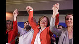 Nathalie Loiseau, center, head of French president Emmanuel Macron's party list, reacts at the campaign headquarters, Sunday, May 26, 2019 in Paris. Exit polls in France indicated that Marine Le Pen's far-right National Rally party came out on top, in an astounding rebuke for French President Emmanuel Macron, who has made EU integration the heart of his presidency. (AP Photo/Kamil Zihnioglu)