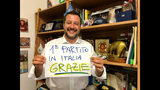 "In this photo provided by the League party press office, Italian Interior Minister, Deputy-Premier and leader of the League party, Matteo Salvini, shows a banner reading in Italian ""First party in Italy, Thanks"", in Milan, Italy, Sunday, May 26, 2019. Italian exit polls indicate Matteo Salvini's right-wing populist League is leading Italian party in European election. (Lega via AP)"