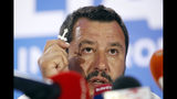 Italian Interior Minister and Deputy Premier Matteo Salvini, of the League, holds a crucifix as he talks to reporters during a press conference at the League headquarters in Milan, Italy, early Monday morning, May 27, 2019. (AP Photo/Antonio Calanni)