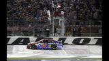 Martin Truex Jr. (19) crosses the finish line to win the NASCAR Cup Series auto race at Charlotte Motor Speedway in Concord, N.C., Sunday, May 26, 2019. (AP Photo/Chuck Burton)