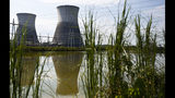 FILE - In this Wednesday, Sept. 7, 2016 file photo, two cooling towers can be seen in the reflection of a pond outside of the unfinished Bellefonte Nuclear Plant, in Hollywood, Ala. Real estate mogul Franklin Haney contributed $1 million to President Donald Trump's inaugural committee and all he's got to show for the money is the glare of a federal investigation. Haney's hefty donation is being scrutinized by federal prosecutors in New York investigating the group's finances. He's also in an unrelated legal battle with the owner of the Bellefonte Nuclear Power Plant, the Tennessee Valley Authority. (AP Photo/Brynn Anderson, File)